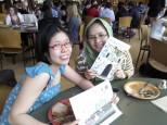 Adela and Winnie enjoying their copies of Translingual 2.0